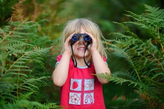 Girl using binoculars © David Tipling - 2020VISION