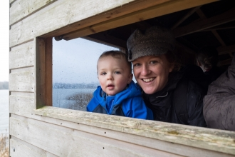 Mum and tot in the bird hide at Blashford Lakes nature reserve