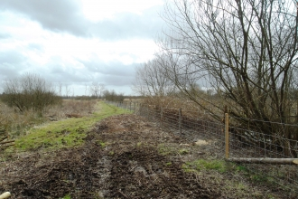 New fencing on the north-south path at Fishlake Meadows