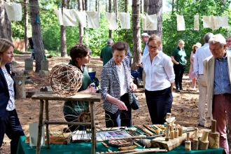 Princess Royal looking at woodland crafts