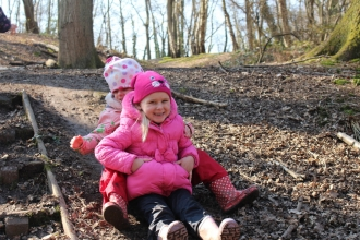 Children on a mud slide, Redlands Year R group at a Forest School session at Swanwick Lakes Nature Reserve on 17th March 2016