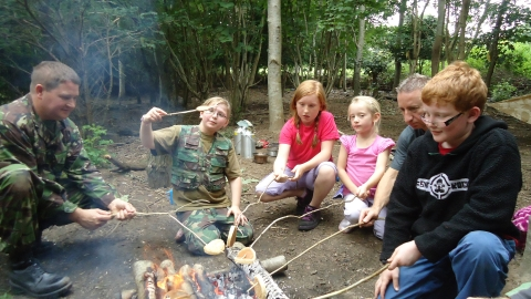 Family Forest School campfire cooking