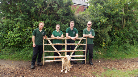 Woodland apprentices with an ash gate hurdle