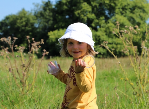 Girl in meadow at St Cross Meadow nature reserve