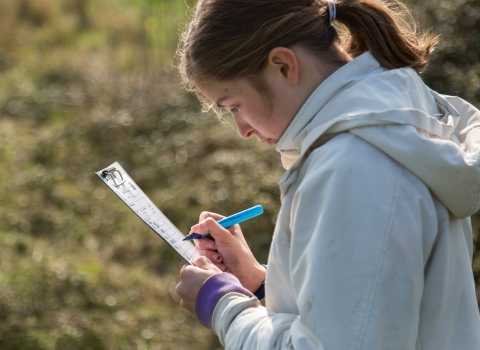 Teenager surveying for species at Milton Locks nature reserve