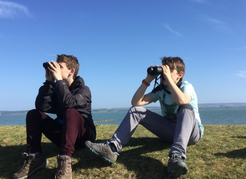Young Naturalists watching avocets